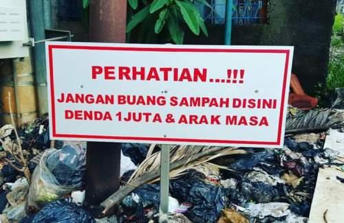 Pengumuman lucu membuang sampah