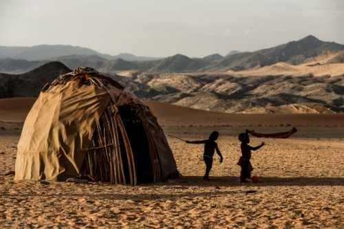 Himba toddlers in their village near Serra Cafema Camp, Namibia.